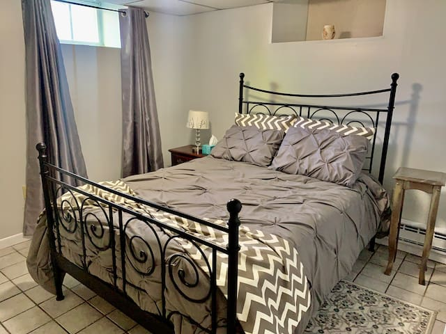Comfortable queen bed and couple night stands with reading lamp, spacious closet with hangers.