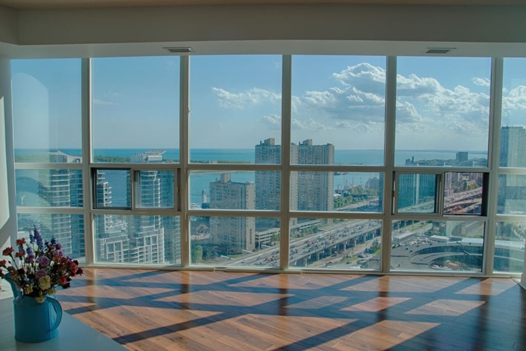 Shared Living Room with floor to ceiling window, unblocked view