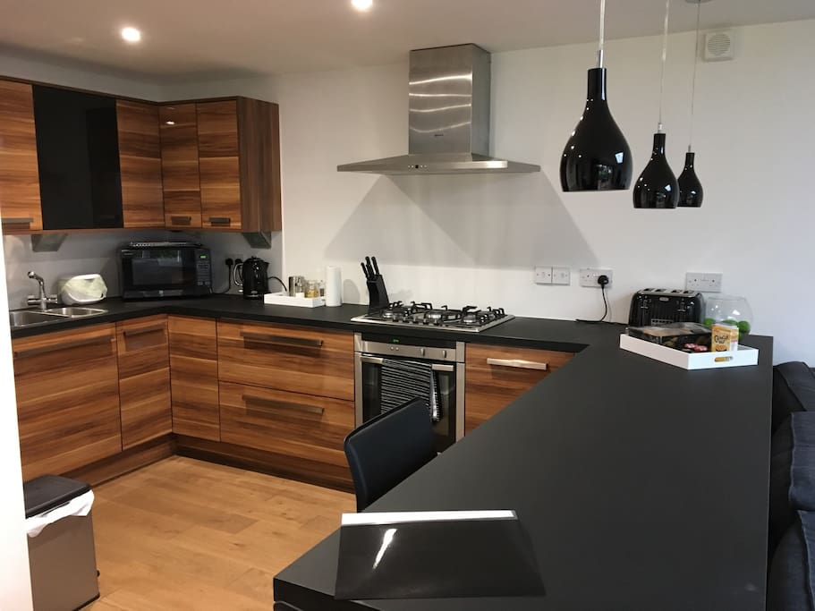 Full fitted kitchen with breakfast bar and USB points for chargers and laptops