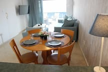 Dining table for four or more guests. There are Kitchenware for up to six people.