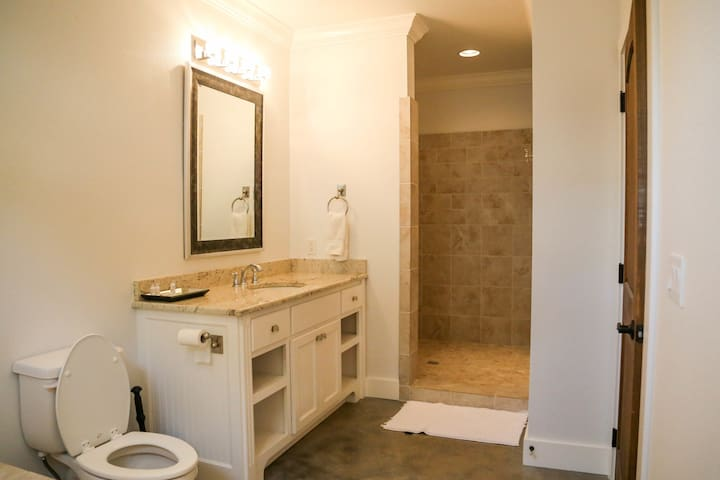 A large bathroom with jacuzzi tub and large walk-in showers!