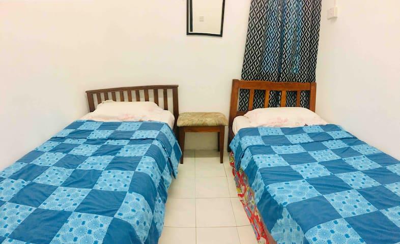 Room 3. This is a small bedroom with 2 twin-sized beds, it is great for sleeping 2 people. Kids will love sleepovers in this room.
