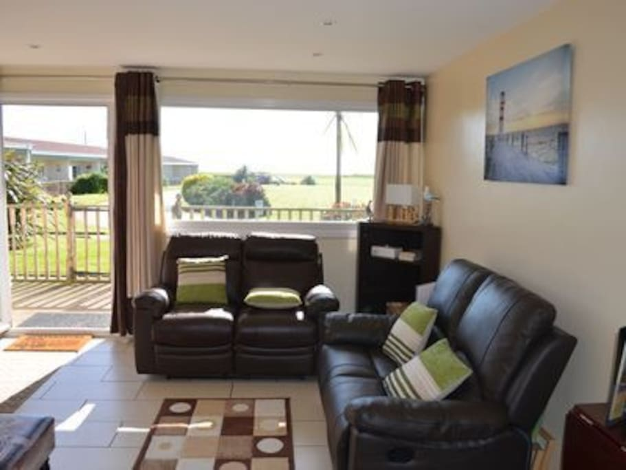 Take it easy in the open plan Lounge with sea views