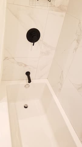 New washroom with Soaker tub just fill up and relax with your choice of Epsom salts or lavender bubble bath.