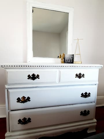 Beautifully hand painted dresser with fun details to make your stay feel homey
