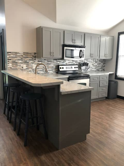 Studio with full kitchen and washer & dryer
