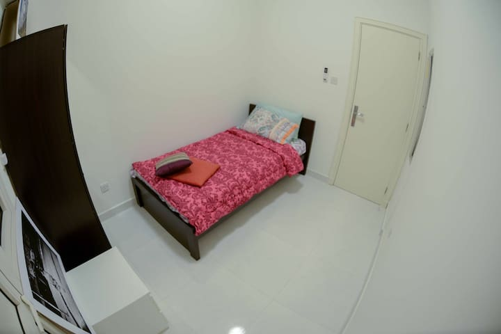 Small room in Equanimity Surf house in Dubai