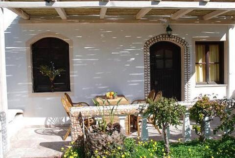 Appartamento pulito e spazioso con veranda e giardino