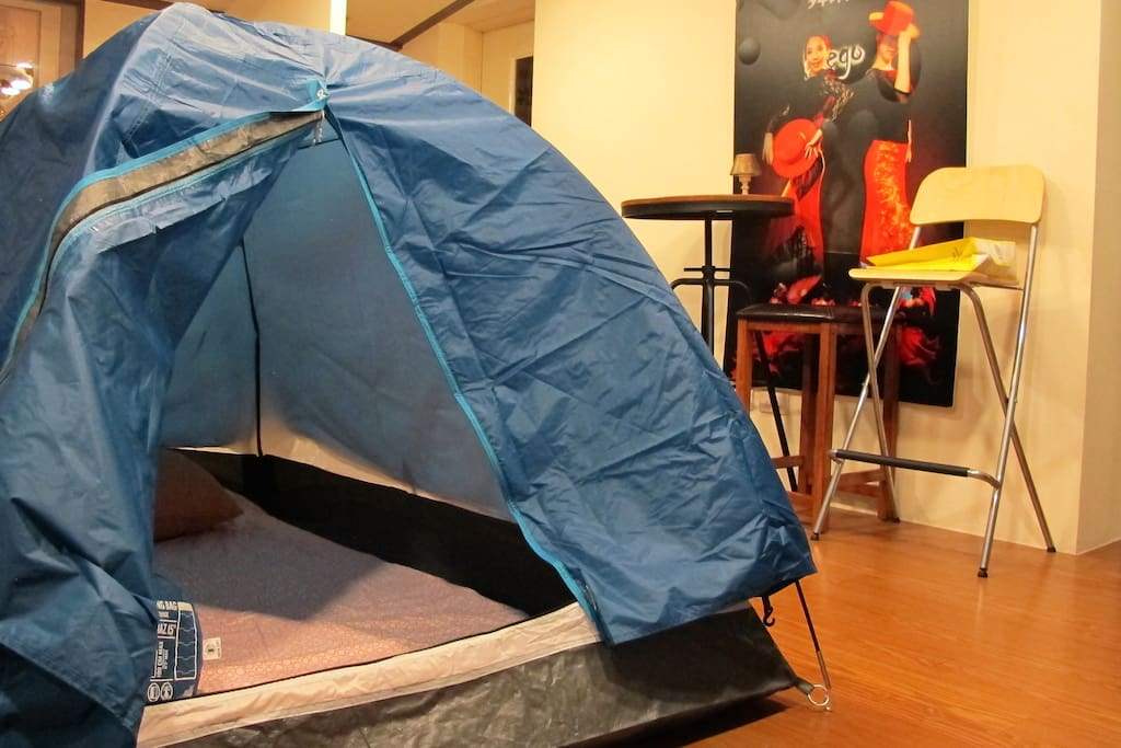 A moderate tent with a comfortable single mattress.