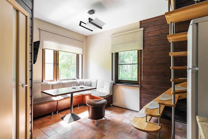 Апартаменты с сауной в коттедже Лесной