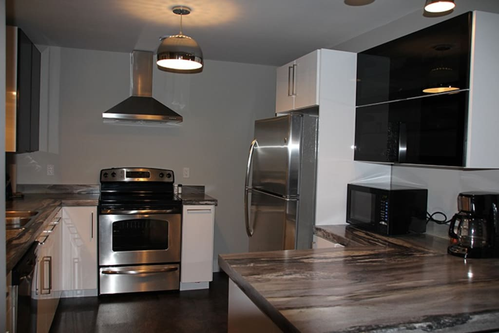 Beautiful modern kitchen, now added a beautiful backsplash (not pictured).