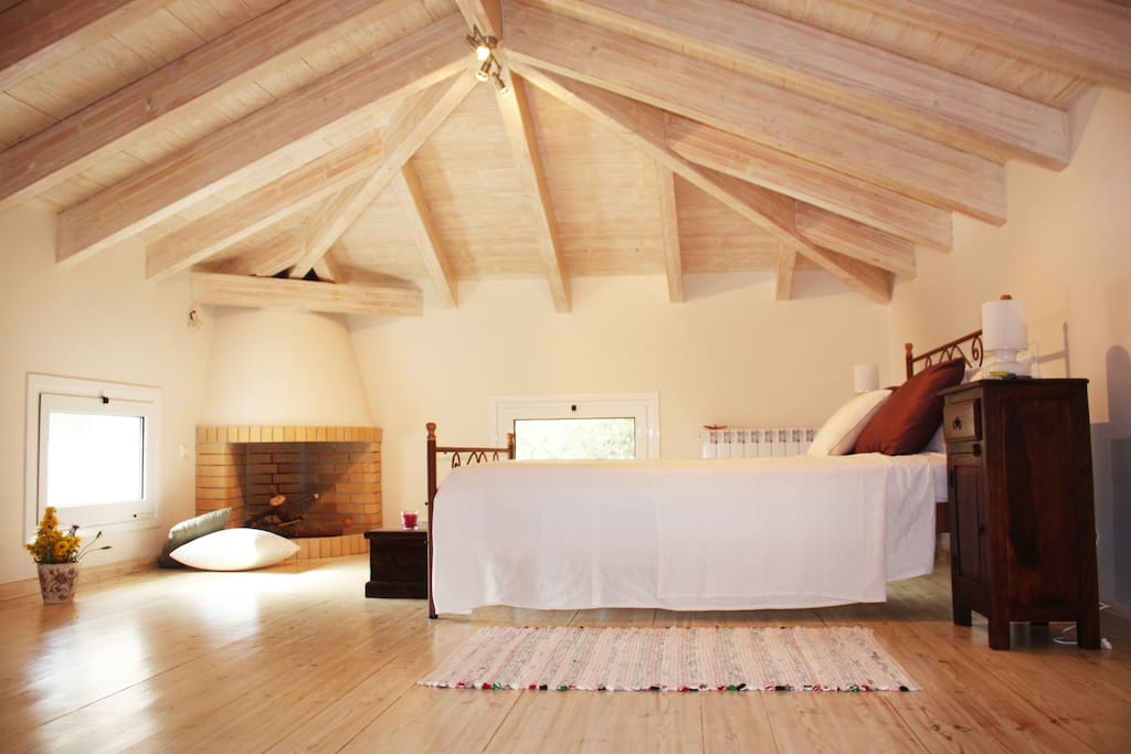 Cozy attic master bedroom (enough room for an extra or baby bed) with  private bathroom
