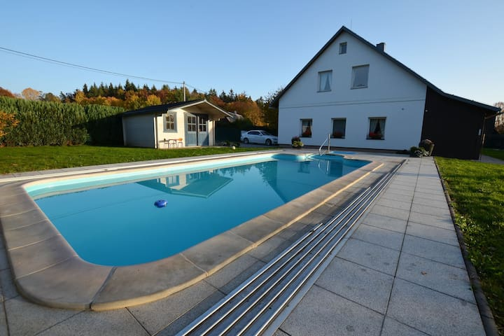 Comfortable apartment with covered pool and fenced garden