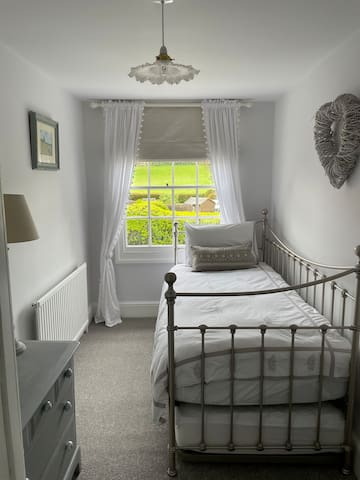 Small room, with day bed, and truggle that pulls out to make a double bed