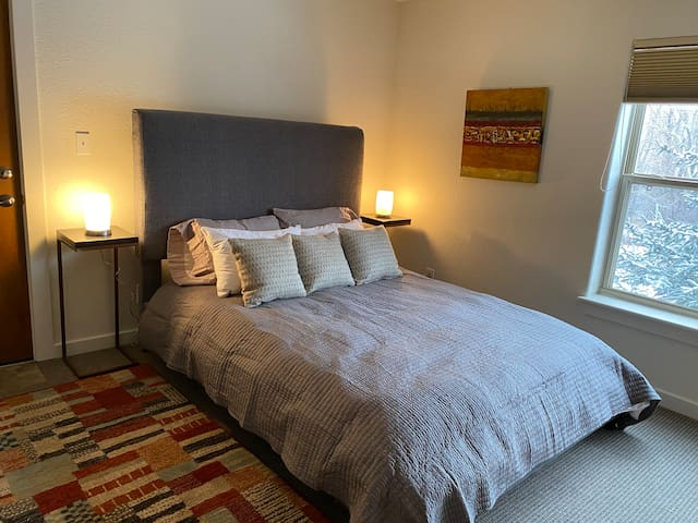 Master bedroom with queen bed, heated mattress pad, luxury bed linens, walk-in closet, attached full bath, tv and desk.
