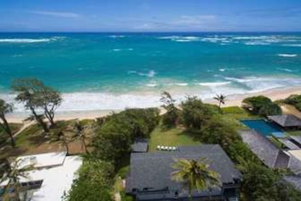 Two homes sit side by side on one of the North Shore's semi-private, sugary white sand beaches. Amazing space for large families or a coroporate retreat. We have an infinity pool, jacuzzi and incredible gardens.