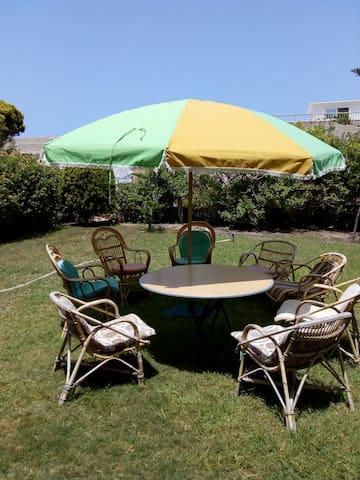 Private garden with nice umbrella