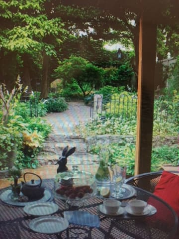 The patio is our summer living room and dinning room at Little House! Enchanting........