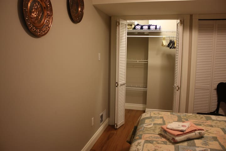 Closet with shelving and lights