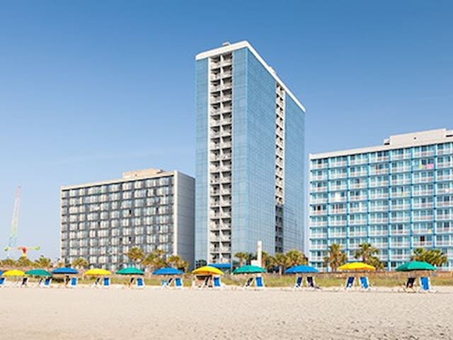 20 story all glass resort -- right on the beach, deluxe oceanfront condo