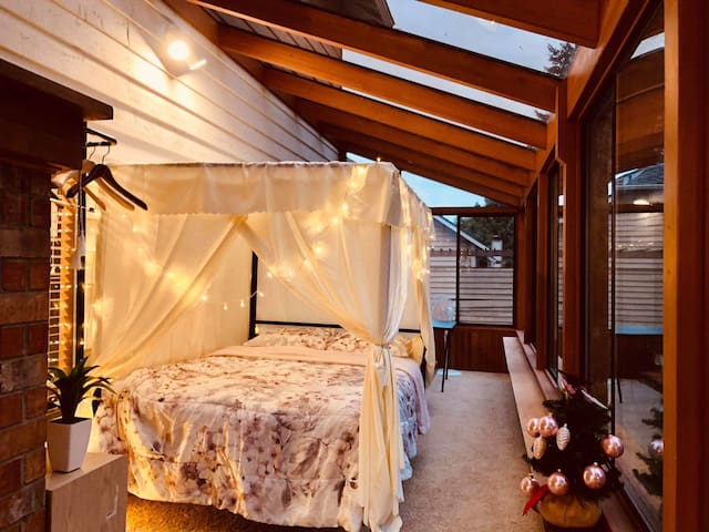 Twilight Sunroom with a Lovely Garden View