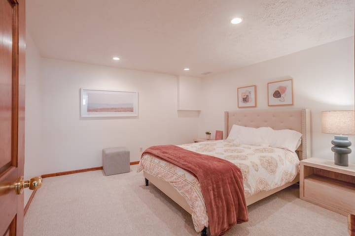 Queen bed with Pottery Barn nightstands and duvet covers