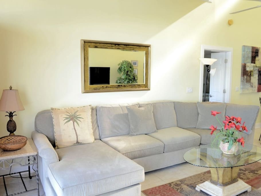 Living Room with New Sofa at 1898 Beachside Tennis