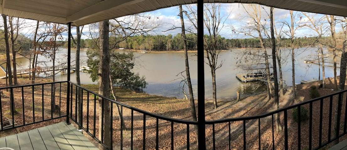 View of White Oak Creek from upper deck. Deck has table and chairs for relaxing.