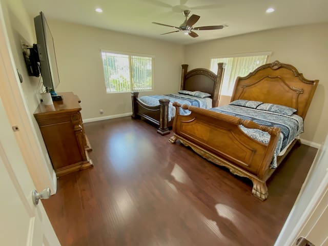 Master bedroom with two queen beds, and private bathroom