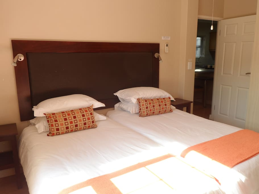 Each bedroom has two single beds and percale linen and towels.