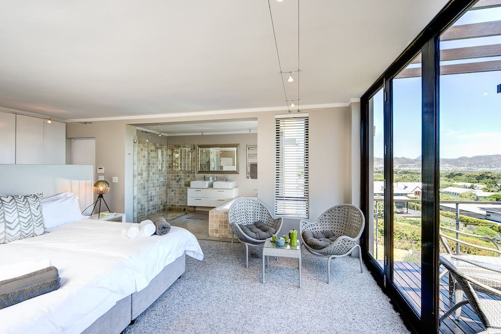 master bedroom with en suite bathroom and balcony with sea view