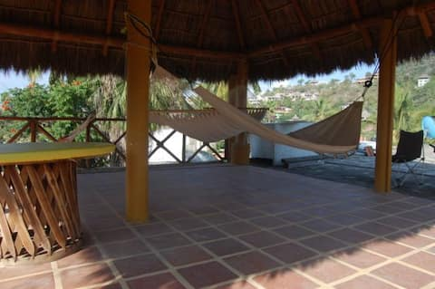 House with palapa and partial ocean view