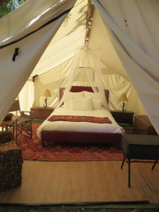 A luxurious Wall Tent with all the creature comforts such as wifi and electricity! Decorated with antiques and rugs collected from around the world.