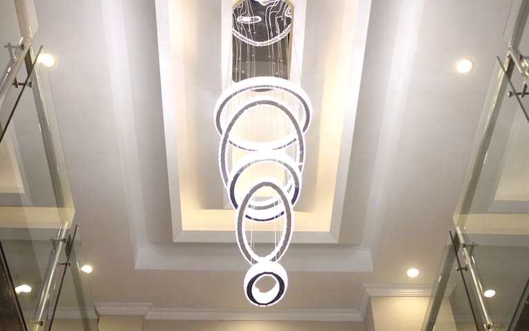 Our lobby lit with modern chandelier