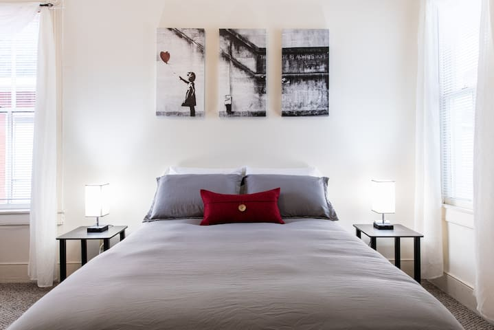 Modern wall art and tasteful finishes - bedside lights include charging stations