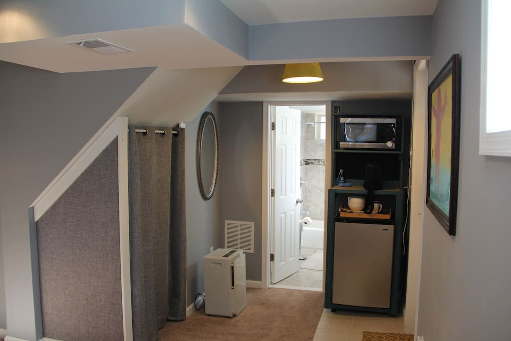 There is a mini fridge and microwave guests can use. We also keep some supplies for guests in the storage on the left.