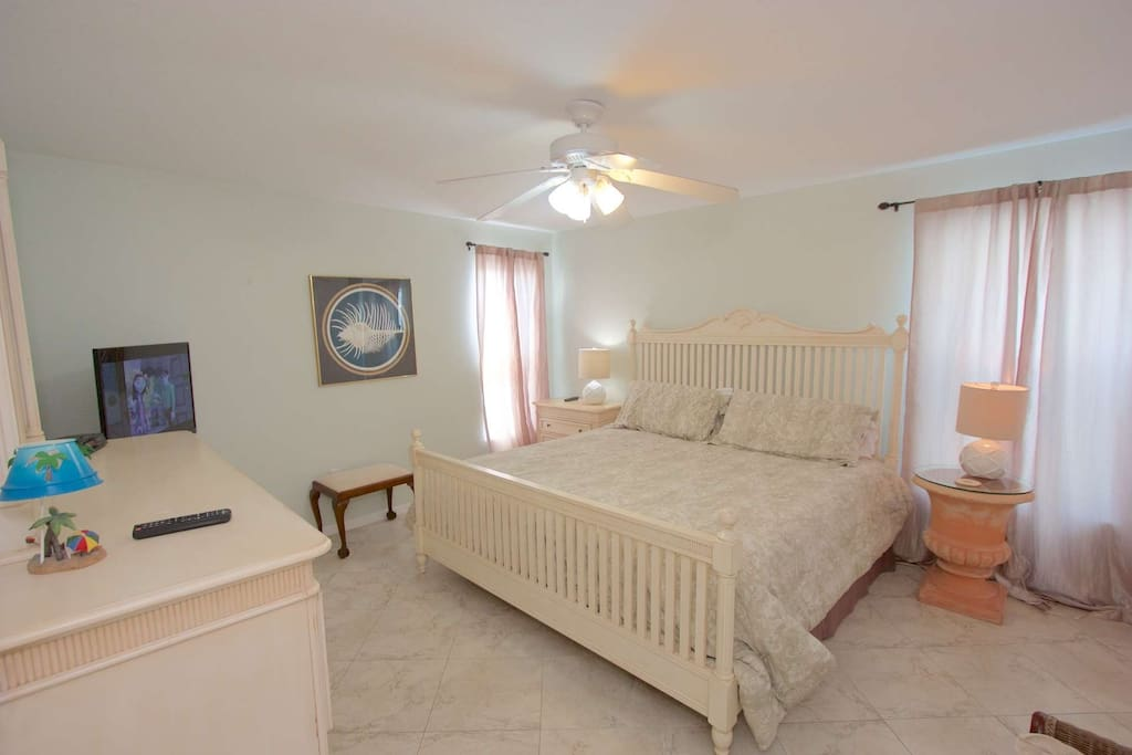 Relax after a great day at The Beach in this Master Suite with King Bed and Flat Screen TV