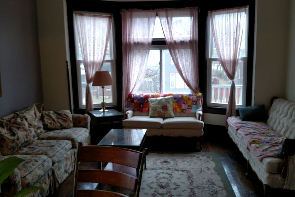 Bay window brings in plenty of East light, pull out queen bed in the sofa on the left.