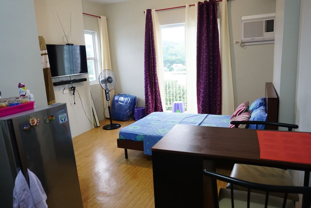 Studio unit with 2 seaters dining set, refrigerator, tv, soundbar, bed and aircon
