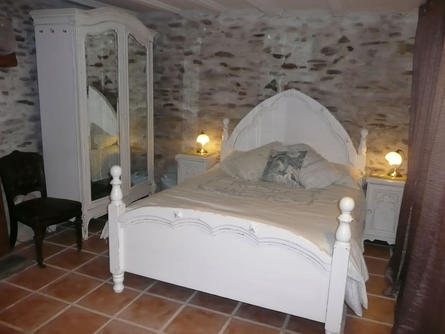 Bedroom with kingsize bed and en-suite shower room