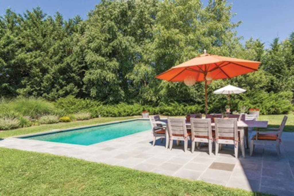 Outdoor dining area with lush garden view/bordering 8 acre preserve