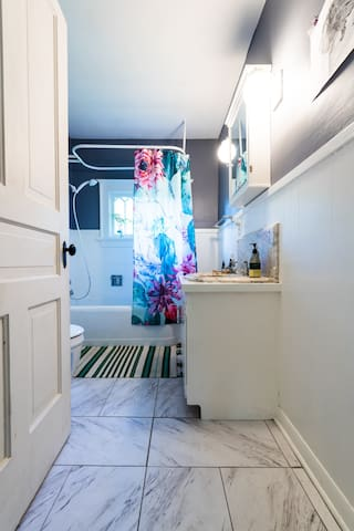 This bathroom has marble details and is shared between Martha's Room and a Room of One's Own.