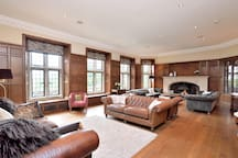 Comfy drawing room with plenty of sofas for all