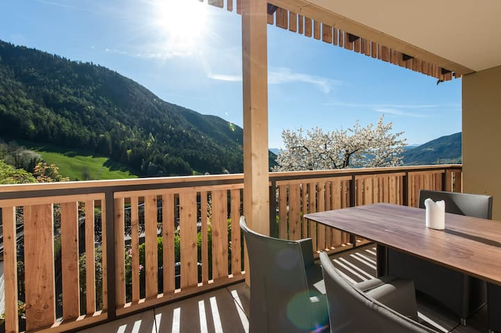 "Charming Apartment ""Sonnleiten Dolomiten Residence - Apt. 5 Sonnenschein"" with Mountain View, Wi-Fi, Pool, Balcony & Garden; Parking Available"