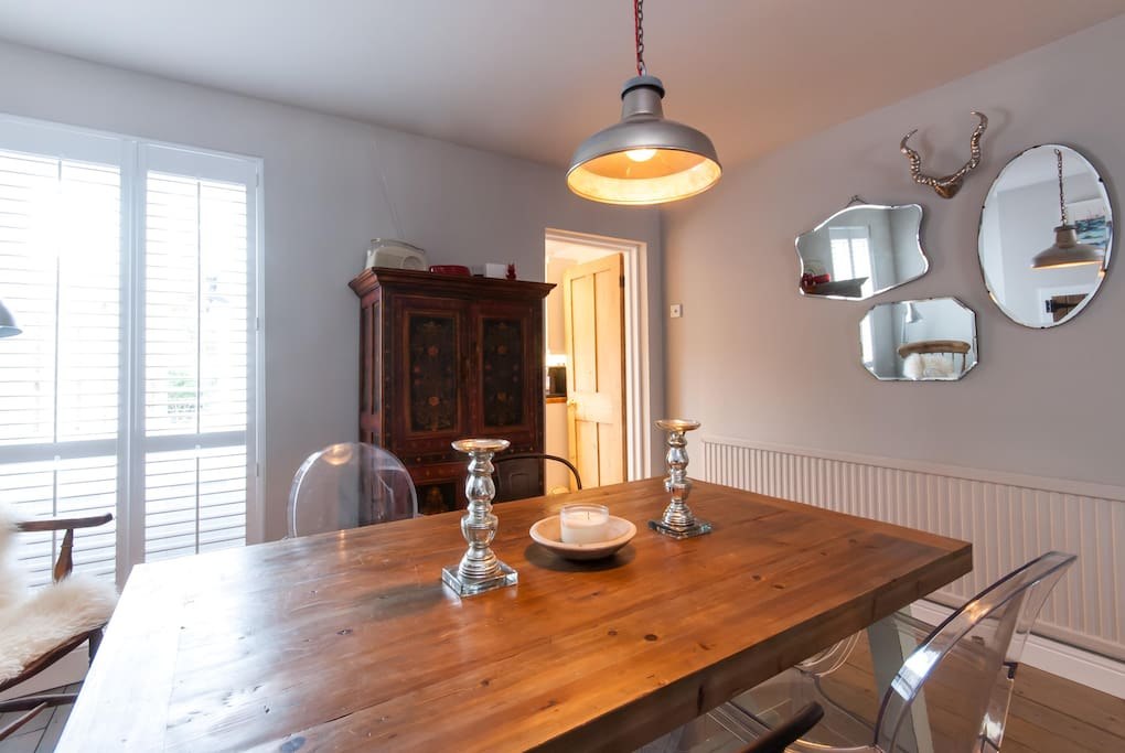The dining area leads from the kitchen and also onto the garden. The dining table comfortably seats six or more at a squeeze!