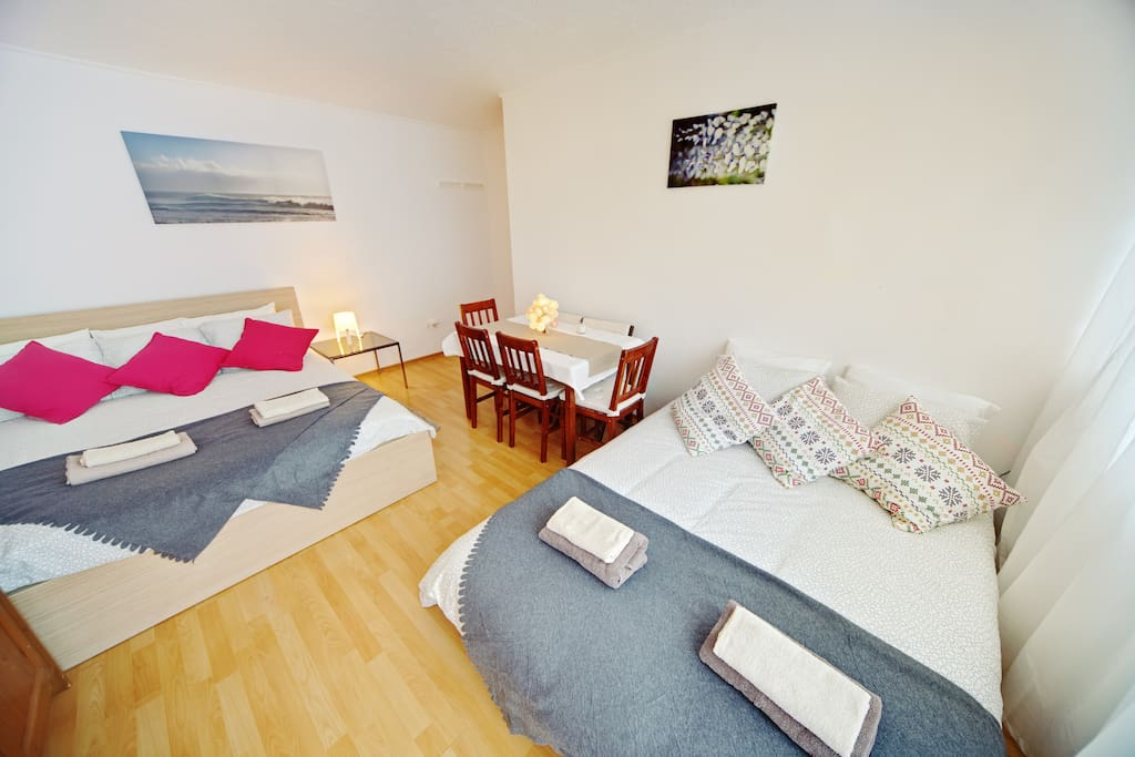 Bedroom with a balcony, lake view, view on avenues taking you to park and tram stop in 1 minute.  Sleeps 4,  Super King Size and Sofa Bed.