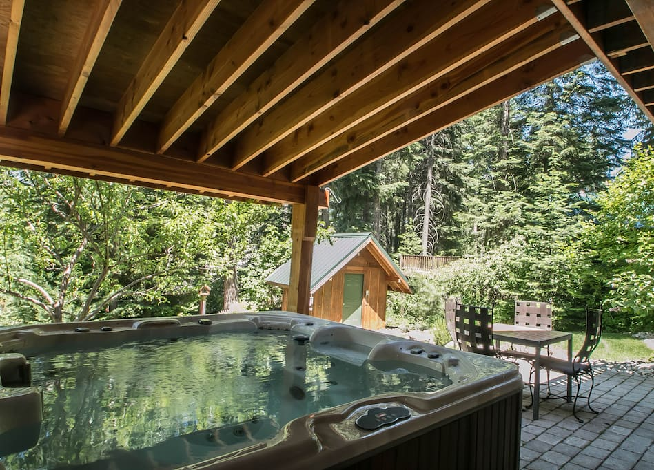 Private hot tub overlooking patio and yard