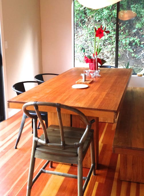 The long wooden dining table will easily fit everyone.