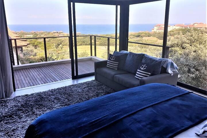 Bedroom #1 - king size bed; sea view; balcony; aircon & roof fan; en suite bathroom