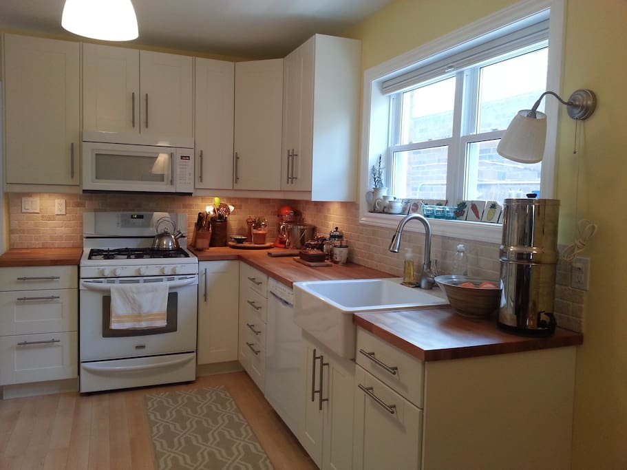 bright, sunny kitchen; all equipment for your cooking needs, with dishwasher